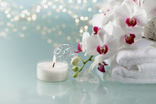 Christmas Or Spa Decoration With White  An Orchid, Soft Towel, Burning Candle On Light Background.