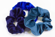 Three Blue Scrunchies On A Bright White Background