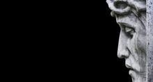 Close Up Ancient Statue Of Jesus Christ Against Black Background