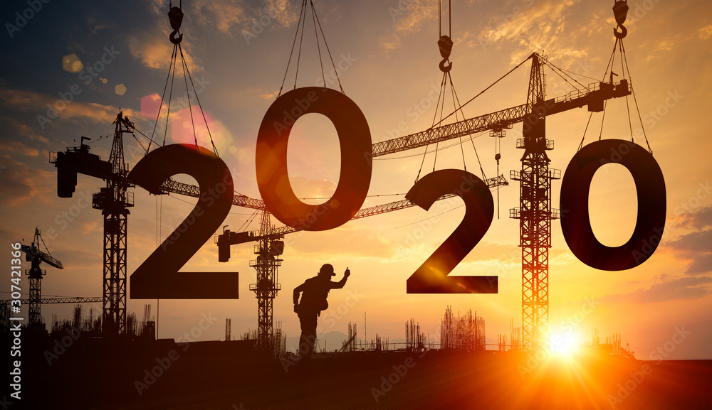 Fototapeta Silhouette construction site,Cranes building construction 2020 year sign