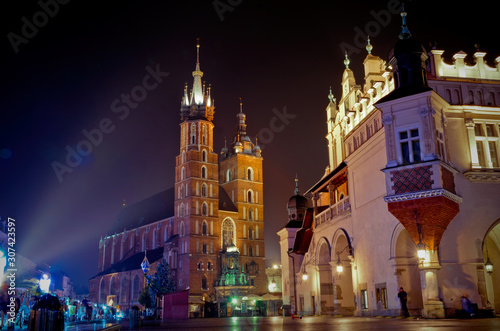 Historic ancient market square in Krakow. Cloth Hall and Mariacki Church