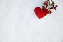 Winter. December. On White Snow Are Sprigs Of Vitamin Dried Orange Rose Hips And A Red Felt Heart.