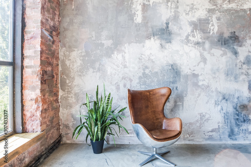Chair in front of the grunge gray wall Wallpaper Mural
