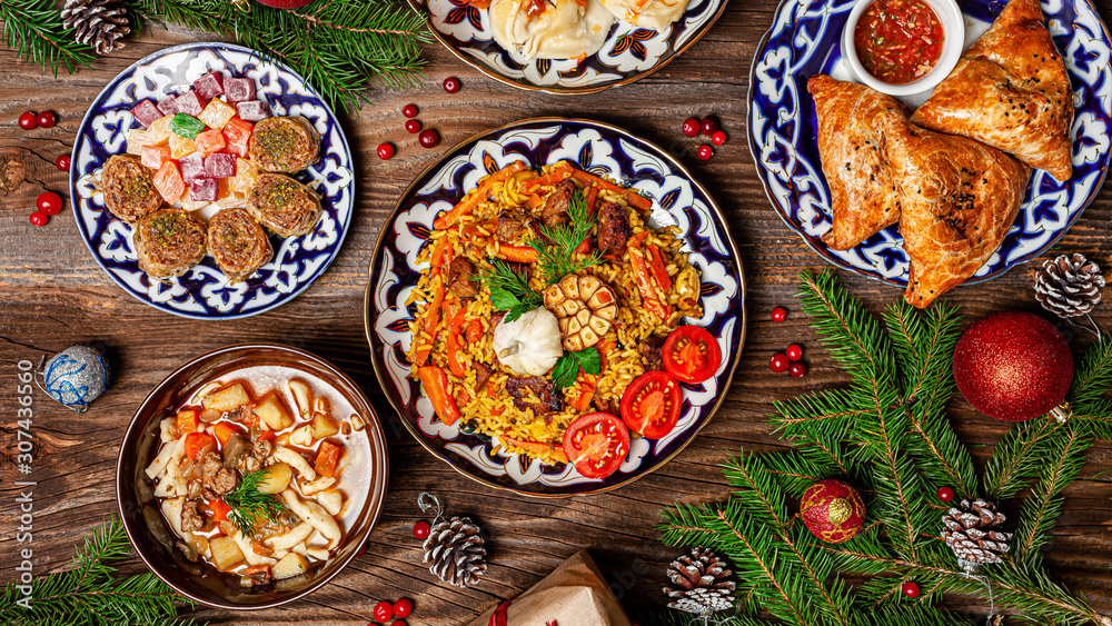 Fototapety, obrazy: Traditional Uzbek oriental cuisine. Uzbek family table from different dishes for the New Year holiday. The background image is a top view