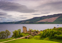 Urquhart Castle In Scotland Next To Loch Ness In The Highlands And Close To The Drumnadrochit Village And Inverness.