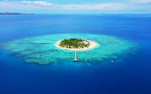 Paradise Island. Aerial View Of Beautiful Mala Mala Island, Fiji, Pacific Ocean. Drone Shot.
