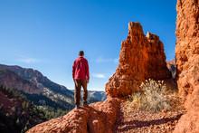 Hiker Standing On Cliff Edge E...