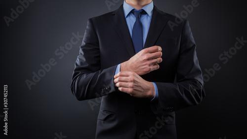 Tela Man in black blue suit with tie