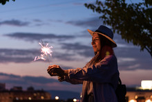 Young Woman Is Holding A Spark...