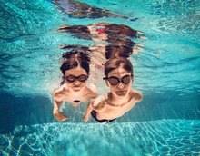 Underwater Image Of Two Boys S...