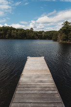 An Empty Dock On A Lake With T...