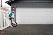 Girl In Pink Helmet Looking Do...