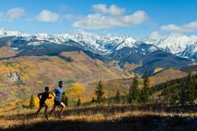 Men Run Ridge With Gore Range Mountain Views In Vail, Colorado