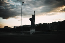 Statue Of Liberty In Paris In The Light Of Evening Sun