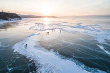 People Walking On Frozen Lake