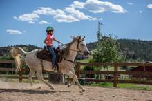 Tween Girl Riding Horse In Outdoor Arena