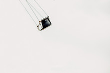Lone Swing On Carnival Ride