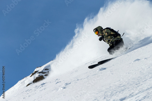 Man off-piste skiing