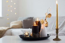 Black And Golden Candles On Wh...