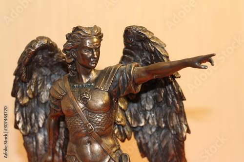 bronze sculpture of Archangel Michael with wings and sword Canvas Print