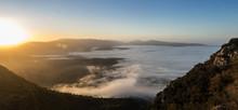 Mountain Mystical Sunrise Over A Foggy Valley