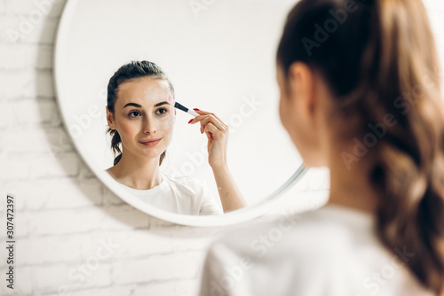 Young beauty accentuated with cosmetics. Wallpaper Mural