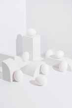 Eggs In White Abstract Setup.