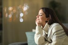 Relaxed Woman Meditating At Ho...