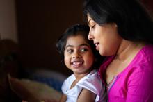 Little Girl Sharing Cheerful M...