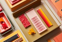 Multicolored Office Supplies On Desk