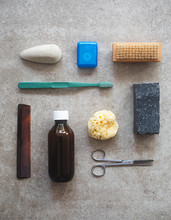 Men's Toiletries - Toothpaste Sponge And Soap On A Concrete Tile