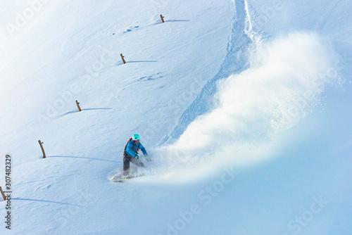 Snowboarder riding on fresh snow