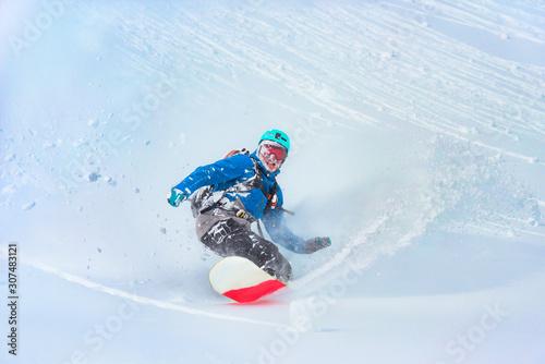 Snowboarder riding
