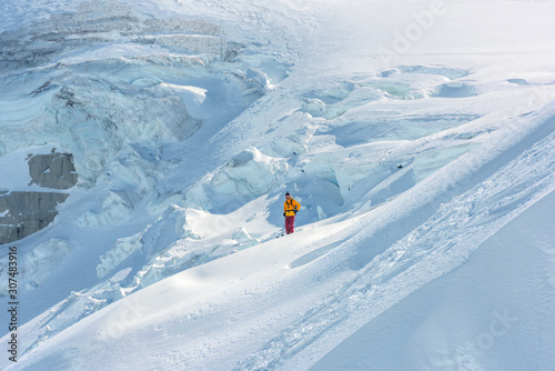 Freeride skier on glacier