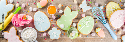 Easter cooking baking background with pastel colored easter cookies, sugar sprinkles and ingredients for bake cake and cookies Canvas Print