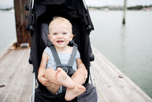 Happy Toddler In A Stroller