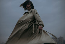Young Woman In Coat Turning Ar...