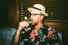 Male In Tropical Shirt Drinkin...