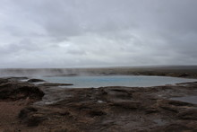 The Original Geysir In Iceland On A Cloudy Day