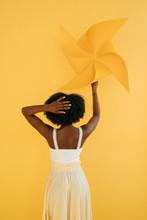Anonymous Black Woman With Pinwheel