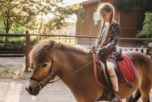 Cute Girl Sitting On A Horseback