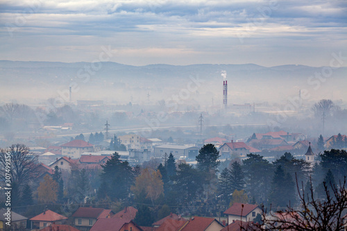 Fototapeta Fog, smog and smoke in Air pollution - Valjevo, West Serbia, Europe