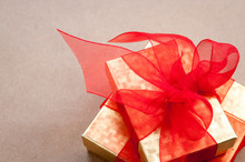 Pair Of Golden Gift Boxes With...