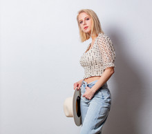 Style Blond Woman In Denim Jeands And Polka Dot Blouse