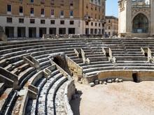 Roman Amphitheater Against Bui...