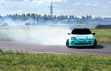 A Sports Car Enters A Turn By ...