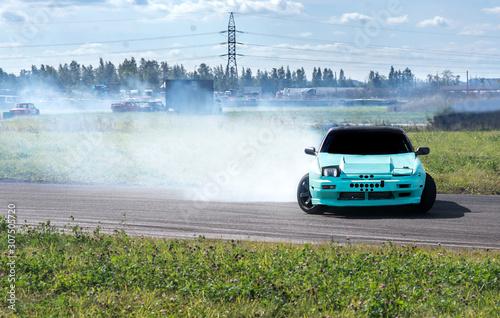 Stampa su Tela a sports car enters a turn by drift