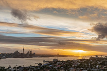 Aerial View Of Auckland Harbour Bridge Over Sea Against Sky In City At Sunset, New Zealand