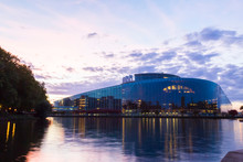 Louise Weiss Building By River Against Sky At Sunset, Strasbourg, France