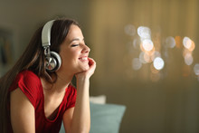 Happy Woman Listening To Music...